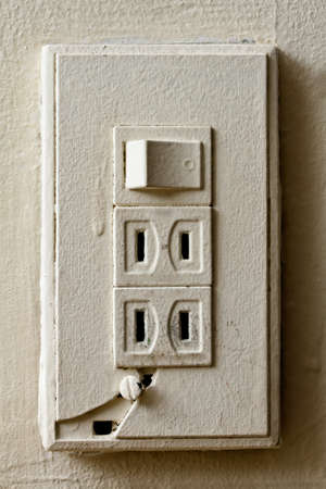 Old broken light switch, closeup image of house object in white. Japan, the USA, Canada and Taiwan socket style. Stock Photo - 9410119