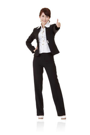 Successful business woman give you an excellent sign, full length portrait isolated on white background.