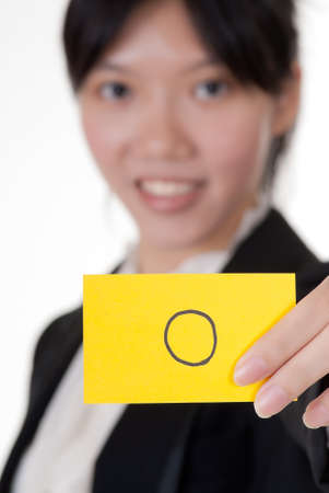 appearance: Right symbol on business card holding by Asian businesswoman.