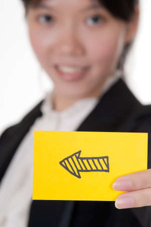 Left arrow on business card holding by Asian businesswoman. photo