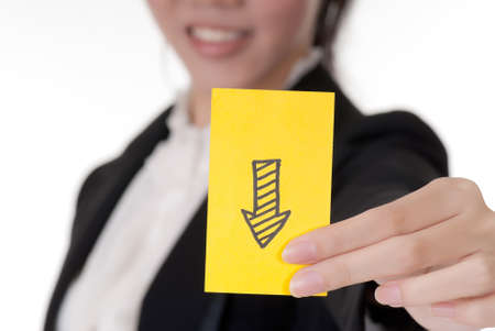 Down arrow on business card holding by Asian businesswoman. photo