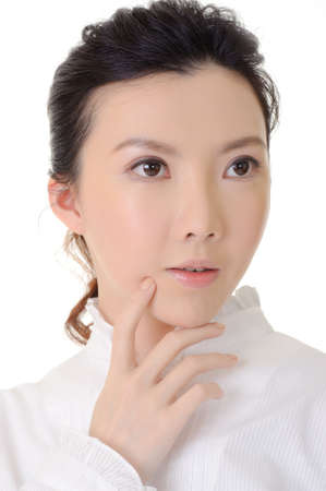 Thinking expression on Asian business womans face, closeup portrait in studio white background. photo