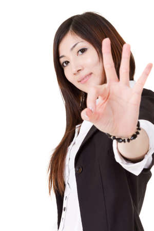 alright: Confident business executive woman of Asian give you an ok sign, half length closeup portrait on white background. Stock Photo