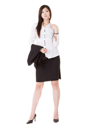 Confident business executive woman of Asian standing and holding her coat, full length portrait isolated on white background. Stock Photo - 9704891