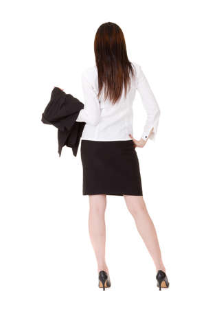Rear view of business executive woman of Asian standing and holding her coat, full length portrait isolated on white background. Stock Photo - 9704895