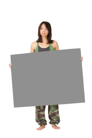 Young woman of fitness holding gray blank board, full length portrait isolated on white background. photo