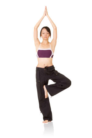 Professional yoga woman exercising,  full length portrait isolated on white background. photo
