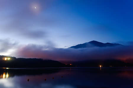 Moon night lake landscape with mist, Taiwan famous attraction, Sun Moon Lake situated in Yuchi, Nantou, Taiwan, Asia. The lake and its surrounding countryside have been designated one of thirteen National scenic areas in Taiwan. photo