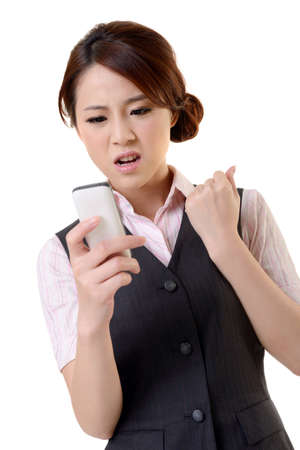 Angry business woman looking message on mobile phone, closeup portrait on white background. Stock Photo - 17453830