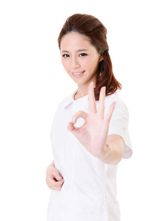okay sign: Smiling Asian nurse give an Okay sign, closeup woman portrait isolated on white background.