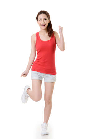 excite: Cheerful Asian sport girl, full length portrait isolated on white background.