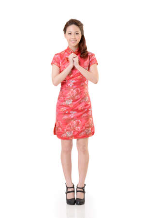 Smiling Chinese woman dress traditional cheongsam at New Year, studio shot isolated on white background. Stock Photo - 17481239