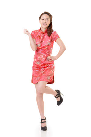 Smiling Chinese woman dress traditional cheongsam at New Year, studio shot isolated on white background. Stock Photo - 17481254