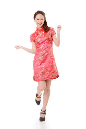 Smiling Chinese woman dress traditional cheongsam at New Year, studio shot isolated on white background. Stock Photo - 17481242