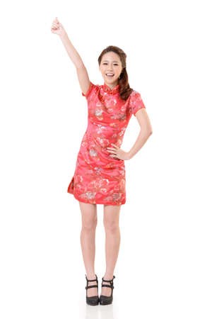Smiling Chinese woman dress traditional cheongsam at New Year, studio shot isolated on white background. Stock Photo - 17481247
