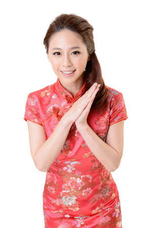 Smiling Chinese woman dress traditional cheongsam at New Year, studio shot isolated on white background. Stock Photo - 17481252