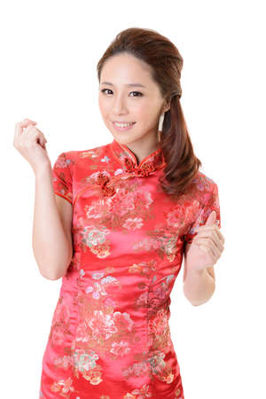 Smiling Chinese woman dress traditional cheongsam at New Year, studio shot isolated on white background. Stock Photo - 17481173