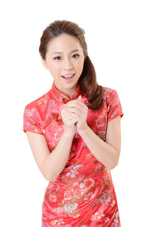 Smiling Chinese woman dress traditional cheongsam at New Year, studio shot isolated on white background. photo