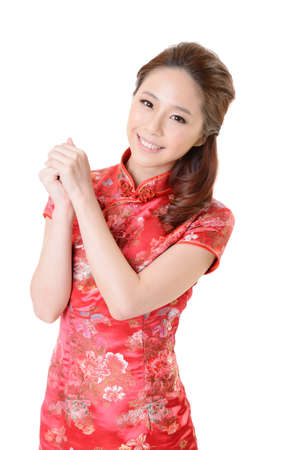 Smiling Chinese woman dress traditional cheongsam at New Year, studio shot isolated on white background. Stock Photo - 17481172