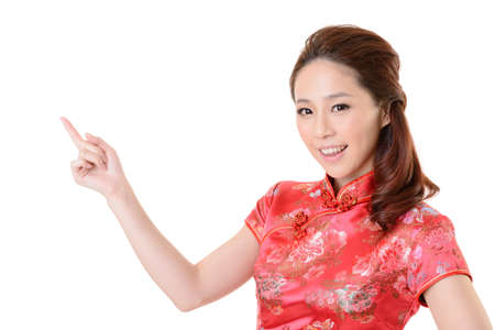 Smiling Chinese woman dress traditional cheongsam and introduce on white background. Stock Photo - 17481175