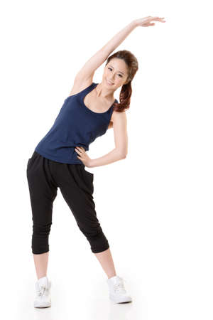 physical activity: Sport girl of Asian doing stretch exercise, full length portrait isolated on white background.