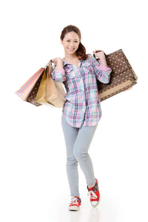 asian shopper: Happy shopping woman of Asian holding bags against white background.