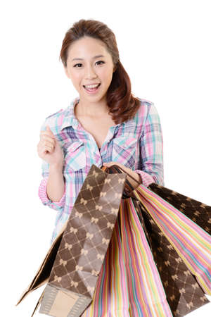 asian style: Happy shopping woman of Asian holding bags against white background.