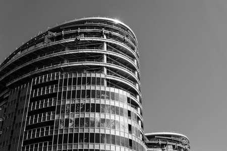 dwell house: Modern skyscraper under construction under blue sky.