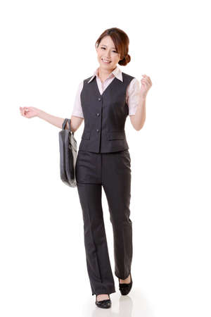 Asian business woman walking against studio white background, full length portrait. Stock Photo - 17692518