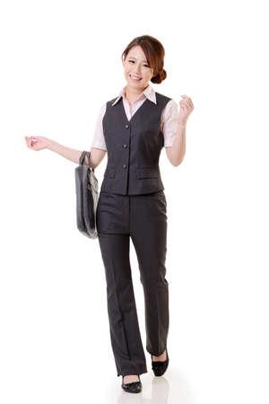 Asian business woman walking against studio white background, full length portrait. Stock Photo - 17692518