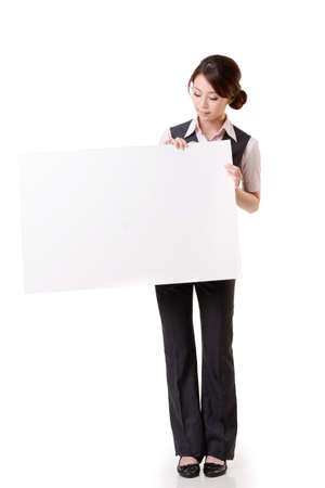 Business woman holding blank board, full length portrait isolated on white background. photo