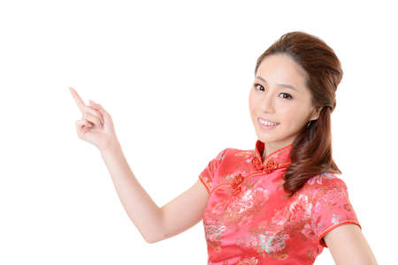 Smiling Chinese woman dress traditional cheongsam and introduce on white background. Stock Photo - 17797983