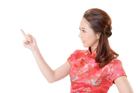 Smiling Chinese woman dress traditional cheongsam and introduce on white background. Stock Photo - 17797987