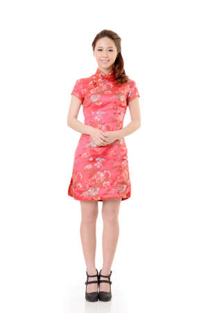 Smiling Chinese woman dress traditional cheongsam at New Year, studio shot isolated on white background. Stock Photo - 17797937