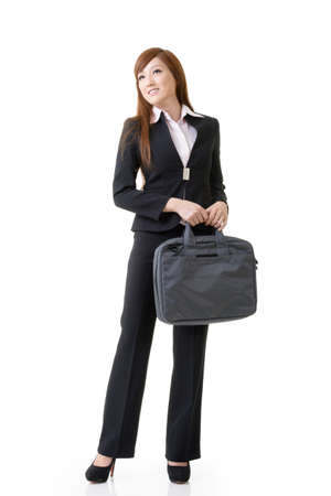 Cheerful business woman of Asian holding briefcase, full length portrait isolated on white background. photo
