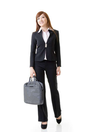 business briefcase: Cheerful business woman of Asian holding briefcase, full length portrait isolated on white background.