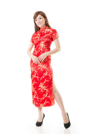 Smiling Chinese woman dress traditional cheongsam at New Year, studio shot isolated on white background. Stock Photo - 17966151