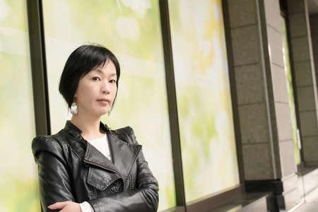 Asian mature woman at street, closeup portrait. photo