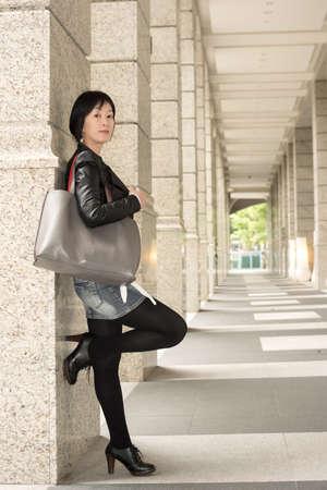 Asian mature woman at street, full length portrait. photo