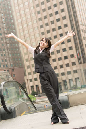 Business woman feel free in outside at modern city. photo