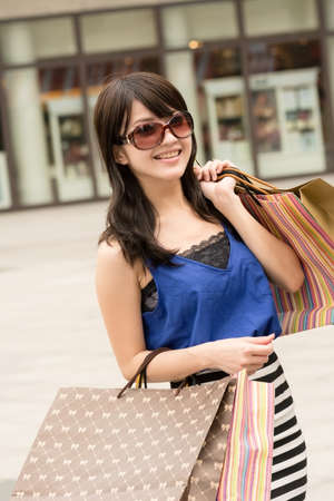 Fashion lady of Asian holding shopping bags in modern city. Stock Photo - 18573964