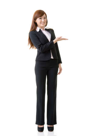 introducing: Attractive business woman showing and introducing, full length portrait isolated on white background.