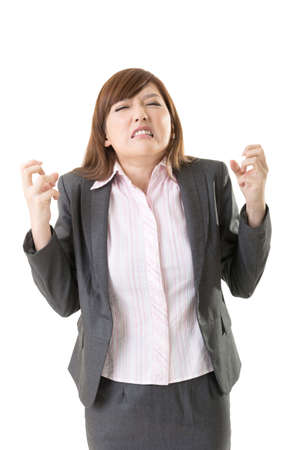 choleric: Angry business woman of Asian, closeup portrait isolated on white background.