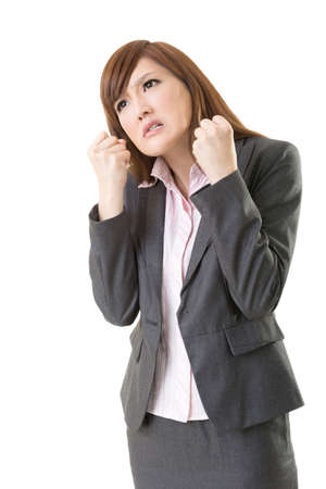provoked: Angry business woman of Asian, closeup portrait isolated on white background.