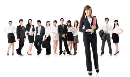 Confident business woman with her team on white background. Stock Photo - 18725025