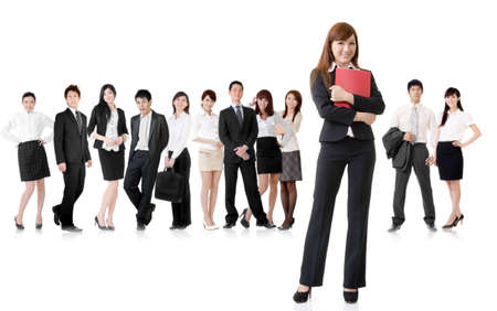 Confident business woman with her team on white background. Stock Photo - 18725028