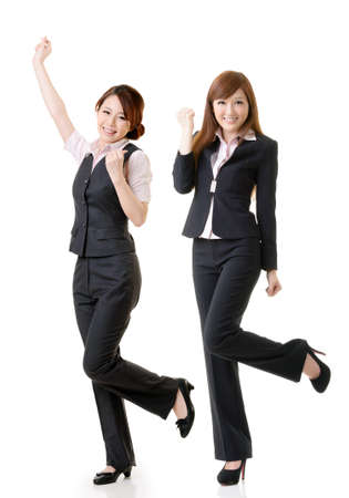 Excited business women, full length portrait of group people isolated on white background.