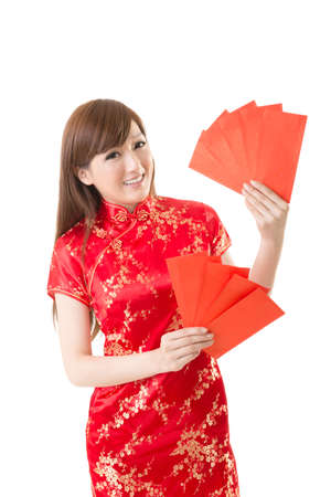 chinese dress: Attractive Chinese woman dress traditional cheongsam and hold red envelope, closeup portrait on white background.