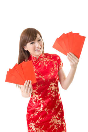 Attractive Chinese woman dress traditional cheongsam and hold red envelope, closeup portrait on white background. photo