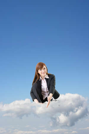 Business woman sit on cloud and shake hand with you over blue sky. photo